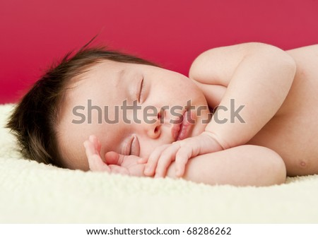Newborn baby sleeping on its side
