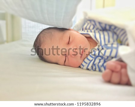 Newborn baby sleeping peacefully. Childhood and innocence concept #1195832896