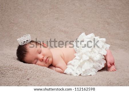 Newborn baby. Sleeping small princess.Shallow DoF.