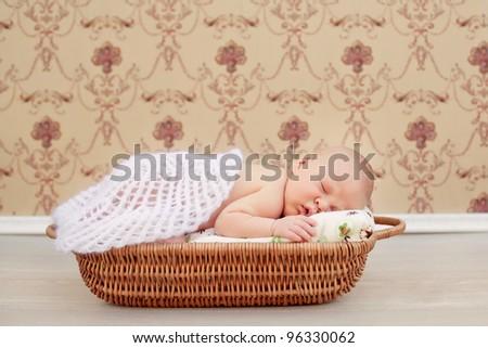 Newborn baby sleeping. Soft focus, shallow DoF. - stock photo