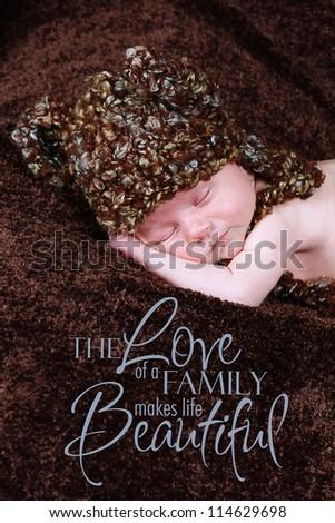 Newborn baby sleeping with Teddy Bear hat on