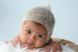 Newborn baby smiling looking at camera,,soft focus,shallow DOF