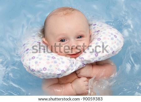 newborn baby swim in blue bathtub with pillow on neck stock photo 90059383 shutterstock. Black Bedroom Furniture Sets. Home Design Ideas