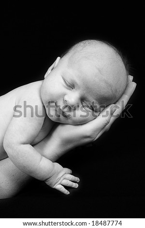 Newborn Baby taken closeup in mother's Hand - black and white