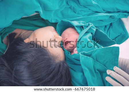 newborn baby with mother and...