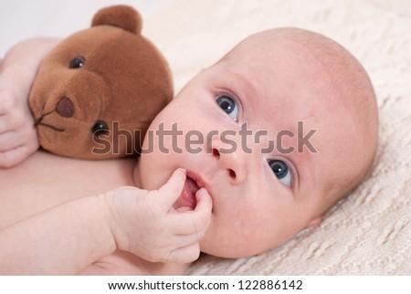 Newborn baby with toy
