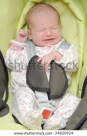 newborn crying in baby safety car chair