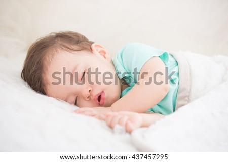 Stock Photo Newborn cute baby sleeping. Closeup portrait, caucasian child