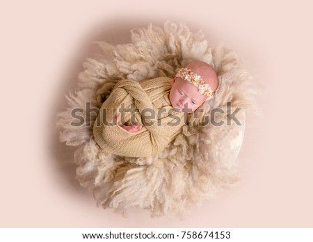 Newborn girl sleeping, wrapped up with a blanket #758674153