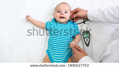 Newborn hearing screening and diagnosis at the hospital. Baby having hearing screening, Otoacoustic Emissions