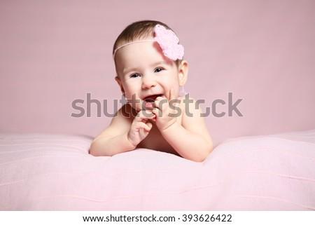 newborn in a cupcake hat