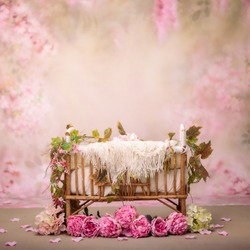 Newborn photography background with tiny bed and pink flowers