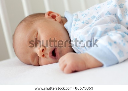 newborn sleeping in a crib