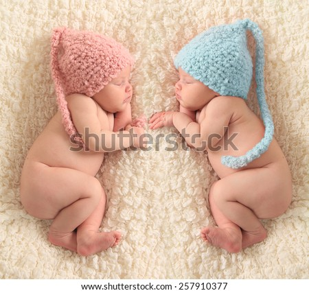 Newborn twin babies, boy and girl