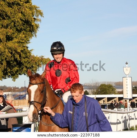 NEWBURY, BERKS - DEC 17: Jockey Dominic Elsworth rides out for the third race December 17, 2008 at Newbury Racecourse, UK - stock photo
