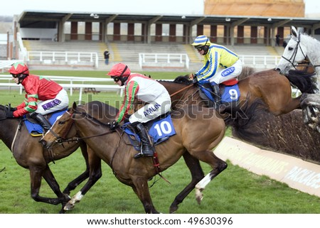 NEWBURY, BERKS- MAR 26:  Paddy Brennan (1st), Tom O'Brien (2nd) and Liam Treadwell (3rd) battle over fences in the second race at Newbury Racecourse, UK, March 26, 2010 in Newbury, Berks