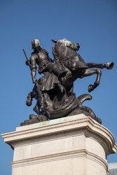 Newcastle / Great Britain - February 27, 2019: War Memorial   statue in Old Eldon Square depicting St George slaying the Dragon, sculpted in bronze.