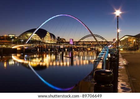 Newcastle quayside at night / Newcastle's quayside and bridges just after sundown showing the colourful lighting