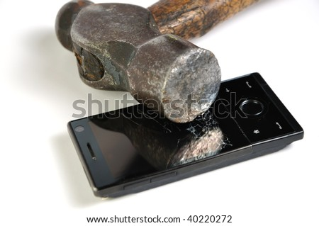 Newer smart phone smashed by a good old fashioned hammer. Isolated on white