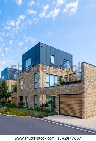 Newly built brick housing in the UK with flat roof in the sunshine  ストックフォト ©