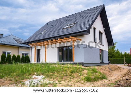 Newly built house with a finished plaster and paint