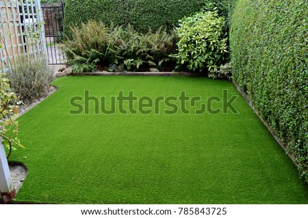 Newly laid artificial lawn in small front garden, East Yorkshire, UK