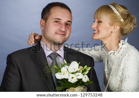 newly married couple in the studio with a bunch of happy
