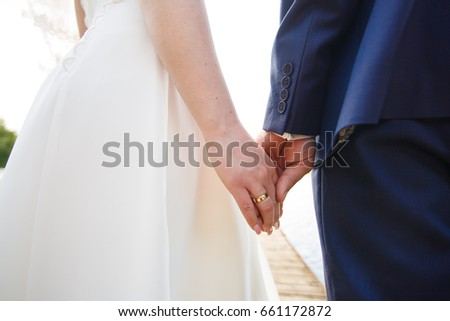 Newly married gently hold hands #661172872