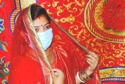 Newly married Indian bahu taking Ghomta or ghunghat/ghoonghat and posing to the camera