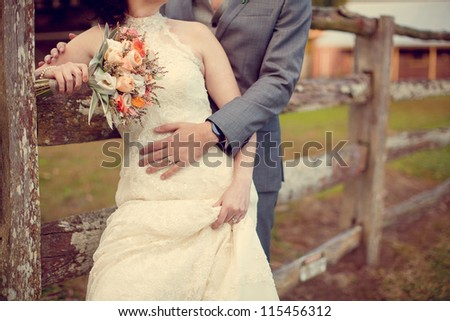 newly married wedding couple embracing each other in a vintage setting