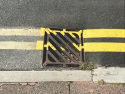 Newly painted double yellow lines on road surface