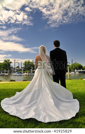 newly wed bride and groom admiring the view on their wedding day