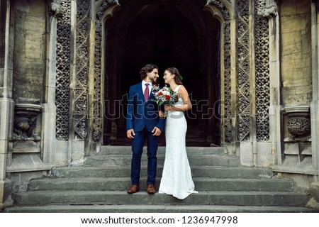 Newly wed couple on the church steps