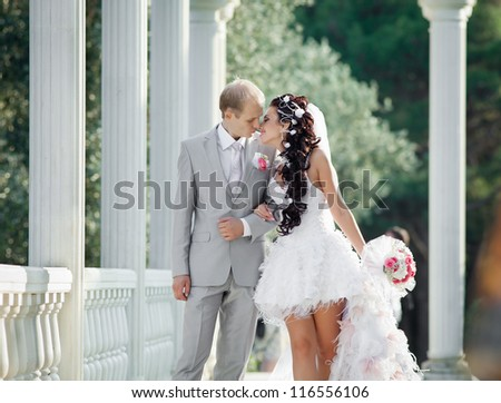 Newly wedded couple in the park. Just married in day of their wedding