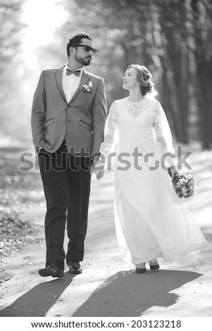 Newlywed caucasian couple together. Wedding day in black and white.