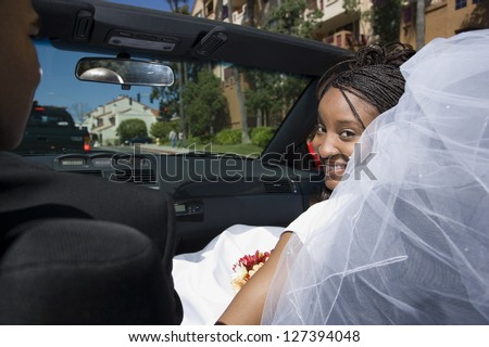 Newlywed couple sitting in the car