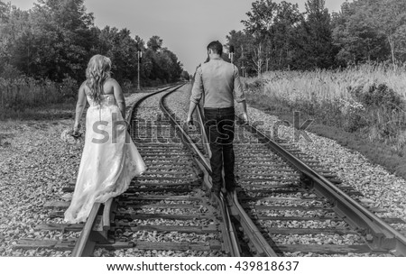 All Girl tied to tracks