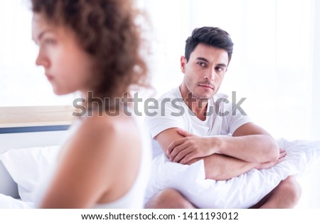 Newlywed have a fight in bed. The couple having difficulties in relationship. Wife always sulking & husband get angry easily. He has problem with erection. Domestic violence & Infertility concept.  #1411193012