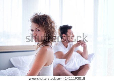 Newlywed have a fight in bed. The couple having difficulties in relationship. Wife always sulking & husband get angry easily. He has problem with erection. Domestic violence & Infertility concept.  #1411193018