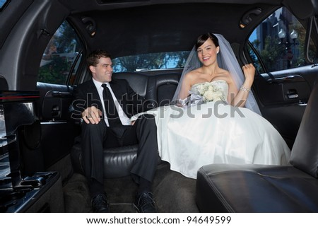 Newlywed in a luxury wedding limousine