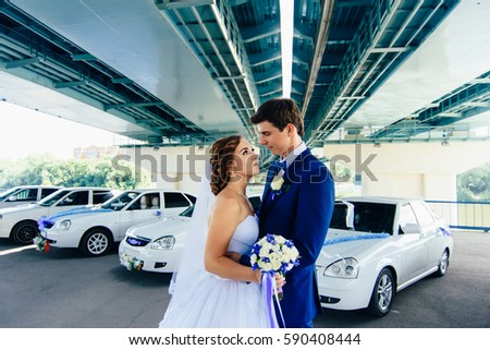 Newlyweds on the background of cars 1 #590408444