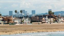 Newport Beach California 3. The coastline of Newport Beach, California on a hazy sunny morning with the Irvine city skyline in the distance.