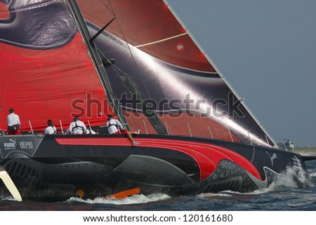 "NEWPORT, RI - JUNE 18: Skipper Ken Read steers PUMA Ocean Racing's ""il Mostro"" during start of the 2010 Newport to Bermuda Race in Newport, RI on June 18, 2010."