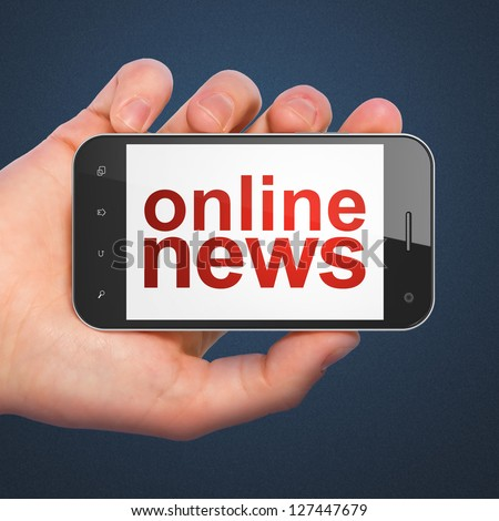 News concept: hand holding smartphone with word Online News on display. Generic mobile smart phone in hand on Dark Blue background.