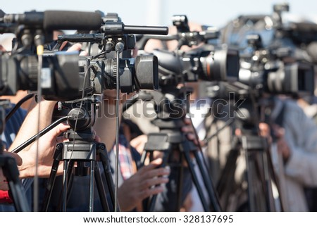 News conference. Filming an event with a video camera.