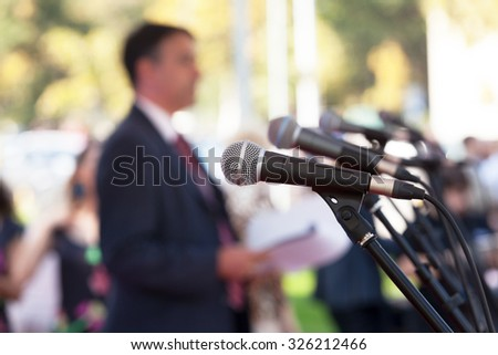 Shutterstock News conference. Microphones.