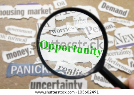 News headlines and magnifying glass with Opportunity text - stock photo