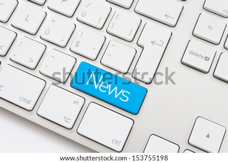 News key on a white keyboard