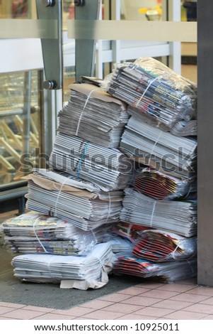 News Papers in doorway of shop
