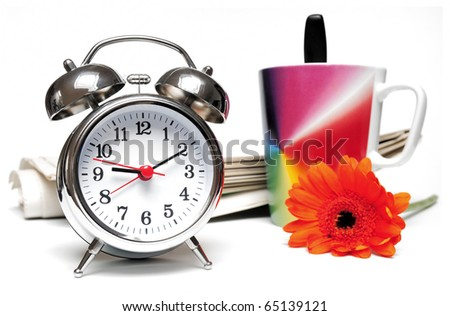 Newspaper, clock, cup of coffee and red daisy on white background